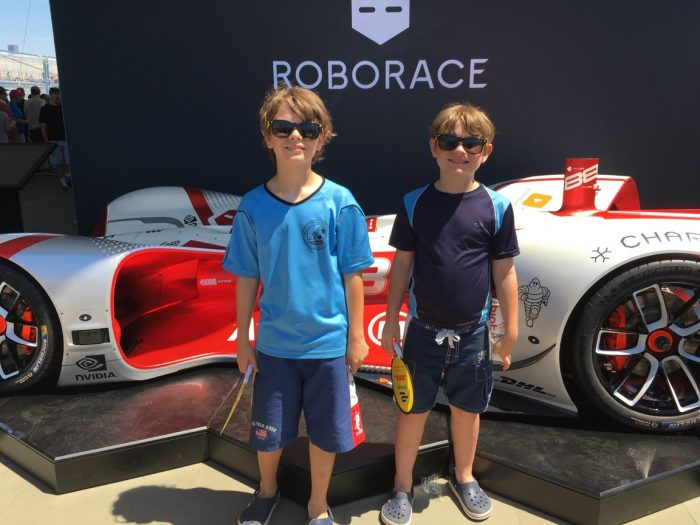 Dylan and Alex with self-drive, electric race car at 2017 Formula E Series, Brooklyn, New York City.