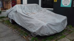 Can you guess what car's under the tarpaulin?