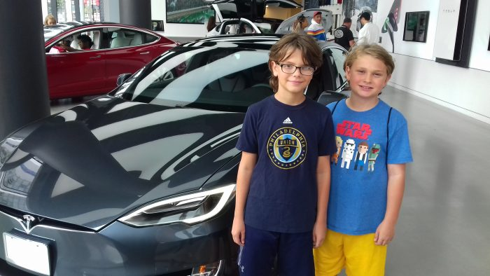 Dylan and Alex with a 2018 Tesla Model 3 at Tesla's NYC showroom, Greenwich Village, Manhattan