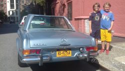 Dylan and Alex with a 1966 Mercedes 280SL
