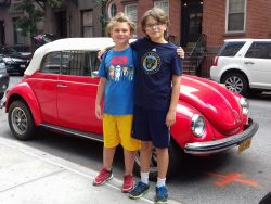 Alex and Dylan with a 1971 Volkswagon Beetle convertible