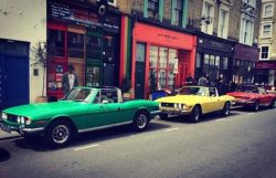 Three Triumph Stag's in a row. Portobello West London UK, circa 1970's