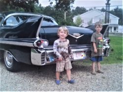 My boys with a 1957 Cadillac Coupe DeVille. Mystic, MA, USA, 2010
